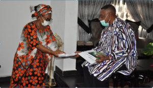 Registrar, Odisa Okeke (Mrs) making a presentation to Prof. Briggs