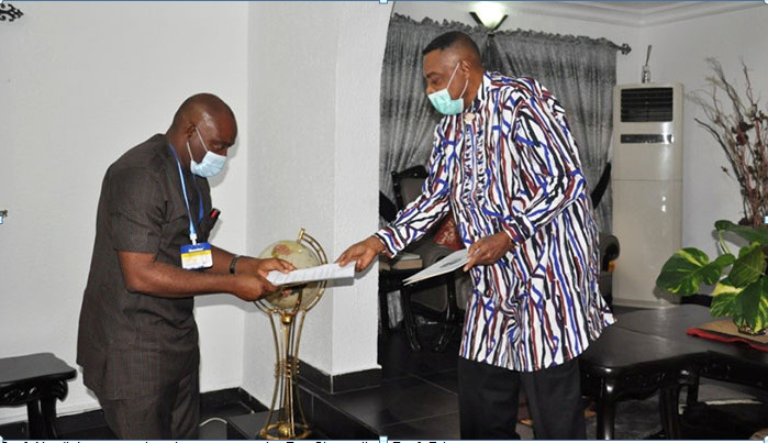 Prof. Nwajiuba presenting documents to the Pro-Chancellor, Prof. Briggs